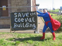 Superman saving the Coeval Building from falling down